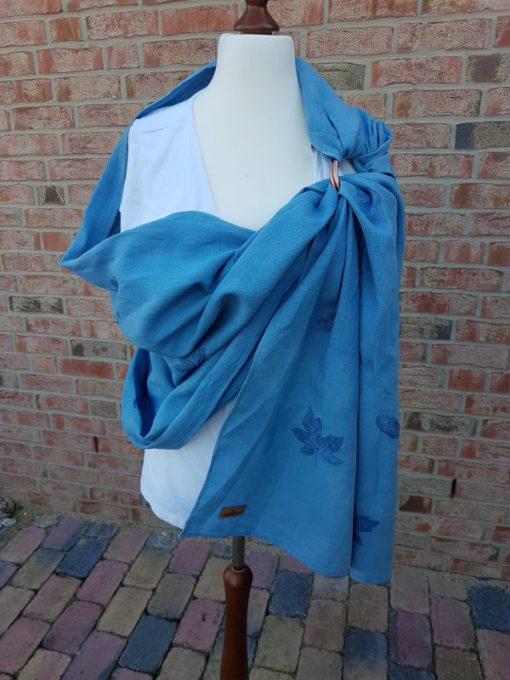 Our blue Ring Sling named Falling Leaves made of hemp